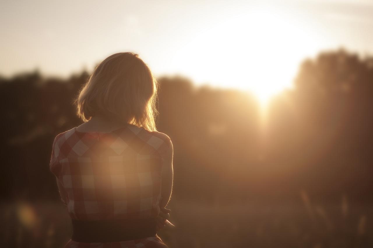 Woman Thinking at dawn